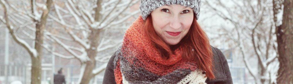grey-crochet-hat-blue-pompom